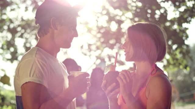 garden party. young people talking and flirting - garden party stock videos & royalty-free footage