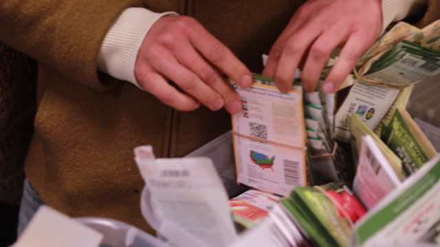 A gardener looks through free packages of gardening seeds during the Seed and Supply Swap at Mother Hubbard's Cupboard Monday February 18 2019 in...