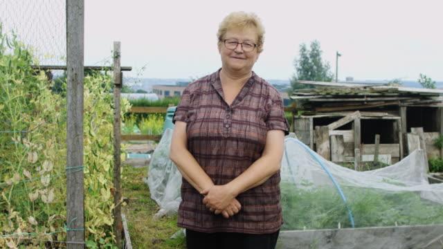 gardener posing in garden - vegetable garden stock videos & royalty-free footage