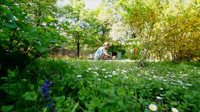 Gardener woman among her flowers and plants