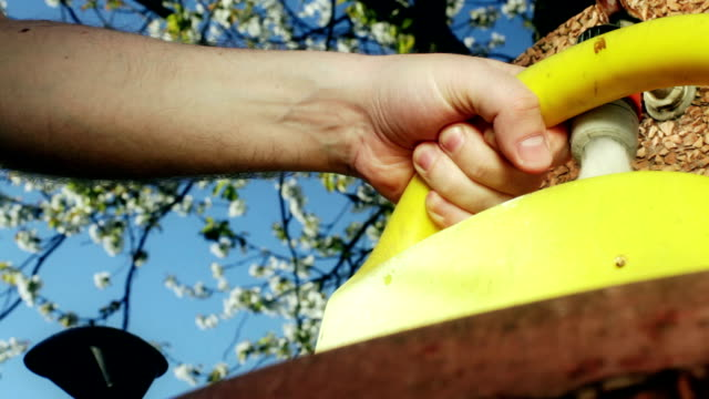 hd: gardening - watering can - watering can stock videos and b-roll footage