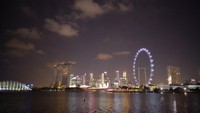 ws gardens by the bay, marina bay sands and the singapore flyer at night - marina bay sands stock videos and b-roll footage