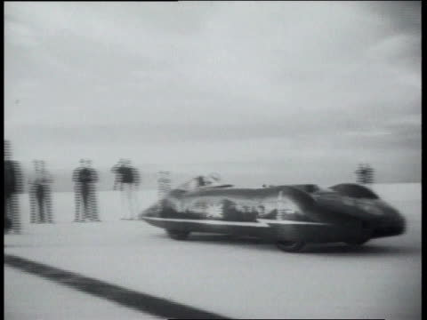 gardner racing after flag is waved / car racing along flats among people and cars - bonneville salt flats stock videos and b-roll footage