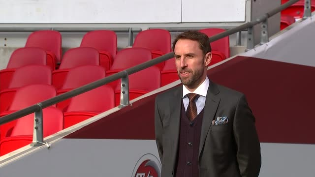 Gareth Southgate photocall Schoolchildren in stands / Gareth Southgate Martin Glenn and Dan Ashworth along onto pitch for photocall / General views...