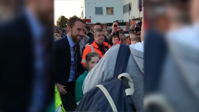 gareth southgate takes pictures with fans outside the vitality stadium in bournemouth, ahead of england u21s match against germany. - bournemouth england stock videos & royalty-free footage