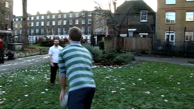 london various of dan harropgriffiths throwing rugby ball to another man in park dan harropgriffiths interview sot - gareth thomas rugby player stock videos & royalty-free footage