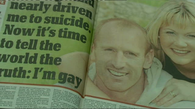 stockvideo's en b-roll-footage met gareth thomas speaks about his decision to go public about his sexuality; lib location unknown: int various close ups of daily mail newspaper article... - artikel
