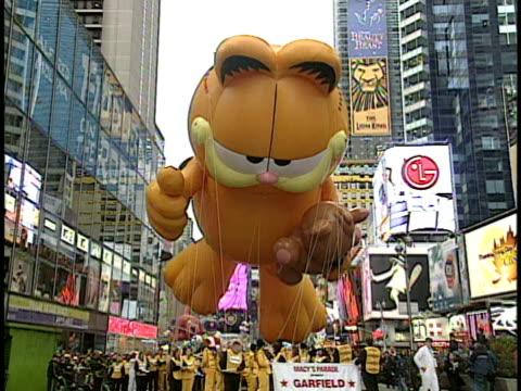garfield parade balloon on thanksgiving day parade new york city new york usa - 2004 stock videos & royalty-free footage