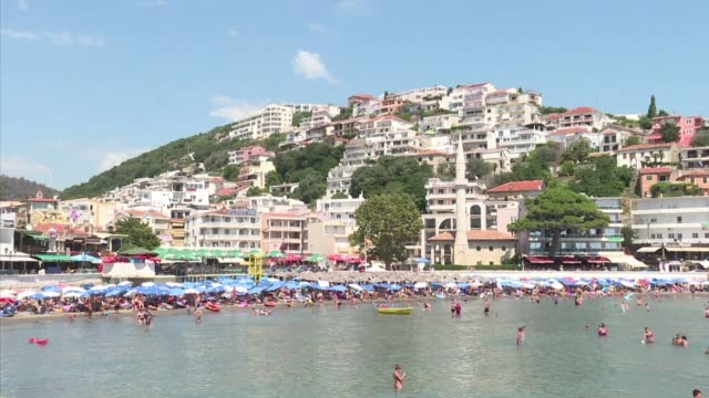 gargantuan cruise ships burgeoning real estate and beaches without a square metre of free sand a tourism boom is devouring montenegro's adriatic... - poet stock videos & royalty-free footage