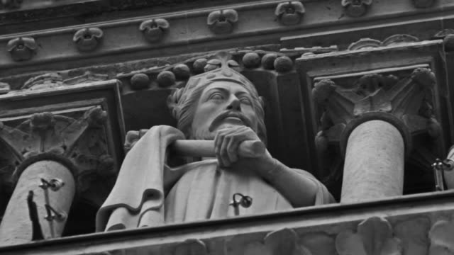 gargoyle and statue details of notre dame de paris, france - male likeness stock videos & royalty-free footage