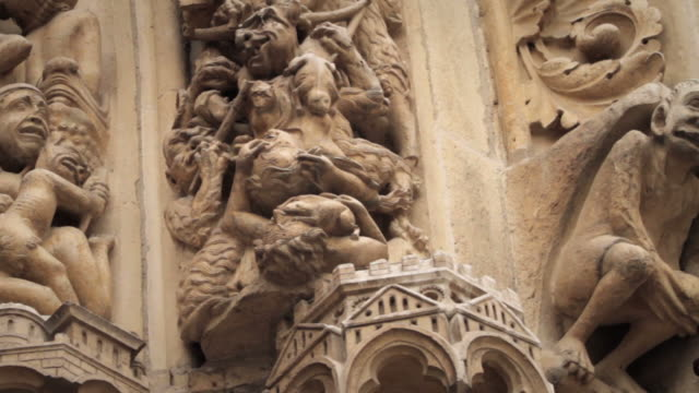 gargoyle and statue details of notre dame de paris, france - notre dame de paris stock videos & royalty-free footage