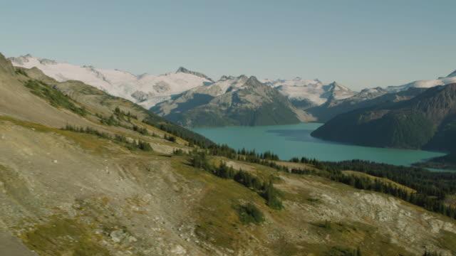 aerial garibaldi lake and rocky mountains at garibaldi provincial park / squamish, british columbia, canada - garibaldi park stock videos & royalty-free footage
