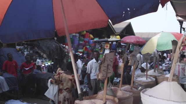 ms garin for sale at market / kampala, kampala, uganda - kampala stock videos & royalty-free footage