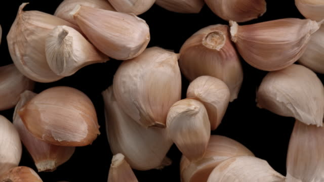 garlic cloves in the air - garlic stock videos & royalty-free footage