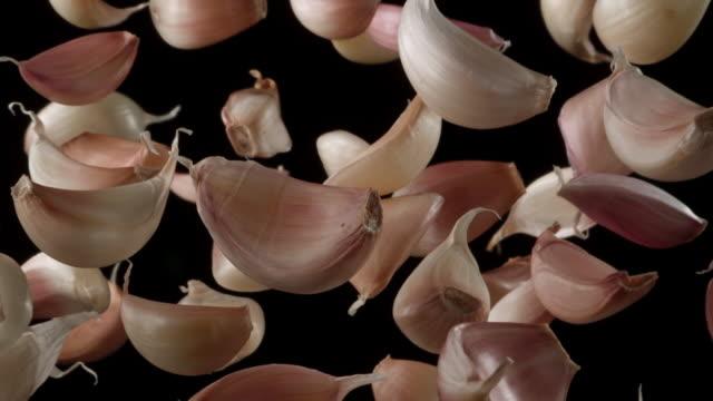 garlic cloves in the air - garlic stock videos & royalty-free footage