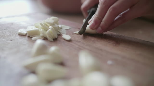 garlic minced - garlic stock videos & royalty-free footage