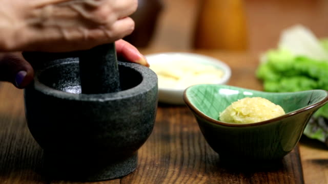 garlic - mortar and pestle stock videos and b-roll footage