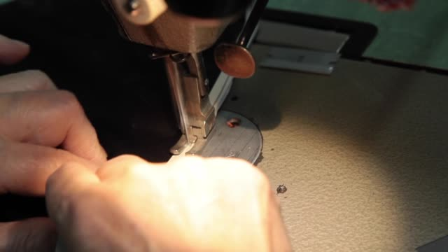 garment factory - sewing a garment - textile mill stock videos & royalty-free footage
