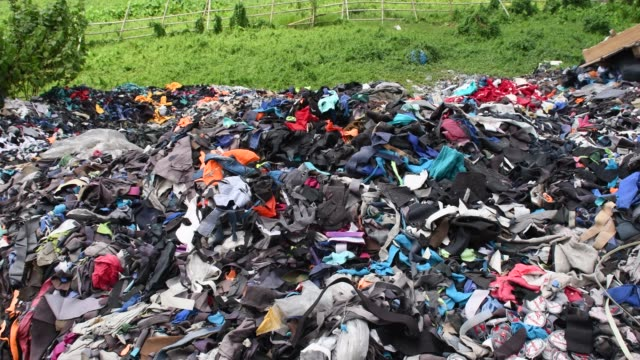 garment factory waste at a dumping site in dhaka - clothing stock videos & royalty-free footage