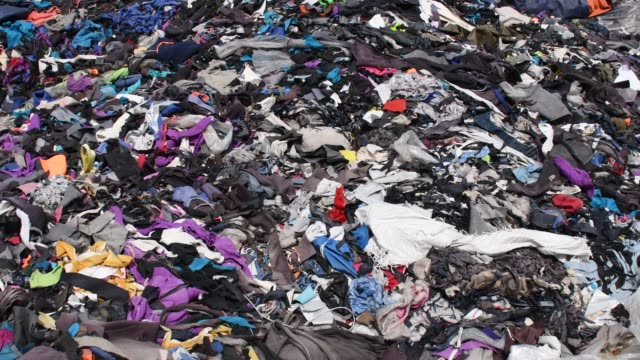 garment factory waste at a dumping site in dhaka - textile industry stock videos & royalty-free footage