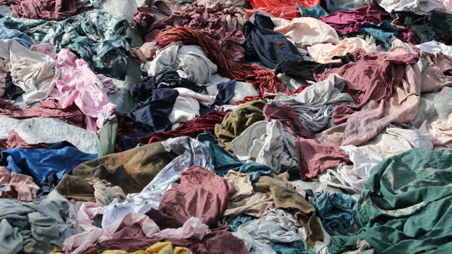 garment factory waste at a dumping site on august 20, 2021 in savar in dhaka, bangladesh.vready-made garment exports in bangladesh amounted to... - clothing stock videos & royalty-free footage