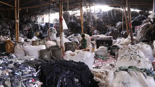 garment leftovers at a jhoot godown in savar near dhaka - unloading stock videos & royalty-free footage