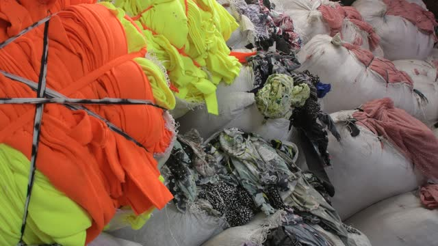 garment leftovers in a storage facility in savar near dhaka, bangladesh on march 15, 2021. - ゴミ捨て場点の映像素材/bロール