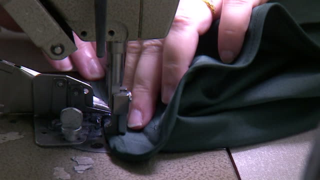 stockvideo's en b-roll-footage met garments being sewed using sewing machine at private white vc sewing factory in salford - kleding