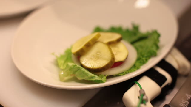 garnish of pickles, onion and lettuce - garnish stock videos & royalty-free footage