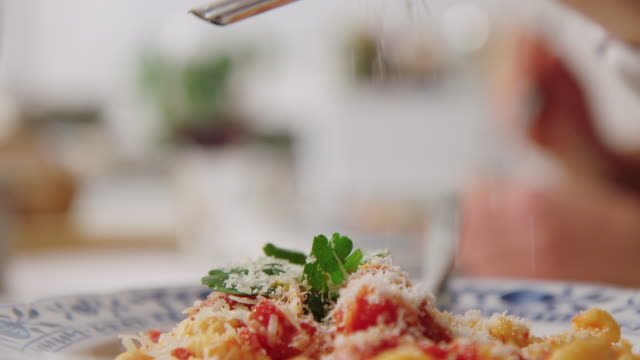 garnishing pasta with grated cheese - italian culture stock videos & royalty-free footage