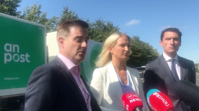 garret bridgeman managing director of an post mails and parcels minister for european affairs helen mcentee and fergal o'leary member of the... - customer stock videos & royalty-free footage