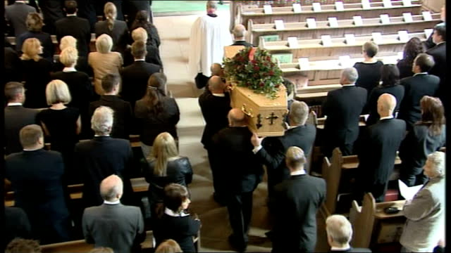 funeral held england cheshire padgate int coffin along at funeral as priest's sermon heard sot - priest stock videos & royalty-free footage