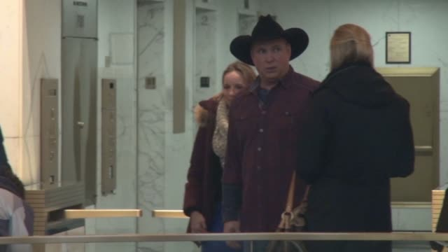 Garth Brooks signs for fans and poses for photos in the lobby of the TODAY show in New York City in Celebrity Sightings in New York