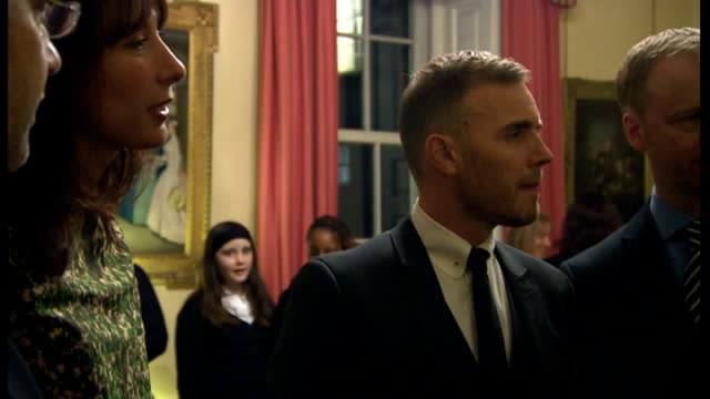 vidéos et rushes de gary barlow to pay back money invested in tax avoidance scheme; lib london: downing street: int shots of gary barlow at charity reception for... - bbc children in need