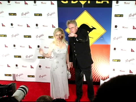 gary busey and vicki roberts at the g'day penfolds black tie gala dinner at the century plaza hotel in century city, california on january 15, 2005. - ゲーリー ビジー点の映像素材/bロール