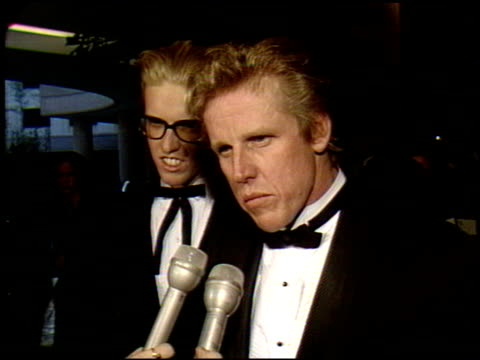 gary busey at the 1990 golden globe awards at the beverly hilton in beverly hills, california on january 20, 1990. - ゲーリー ビジー点の映像素材/bロール