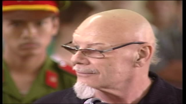 gary glitter begins prison sentence for sex abuse charges; vietnam: vung tau: ext gary glitter led into court by police int court close mid shot... - gary glitter stock videos & royalty-free footage