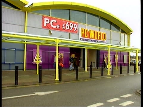 gary glitter questioned by police; htv england: bristol exterior of pc world superstore - gary glitter stock videos & royalty-free footage