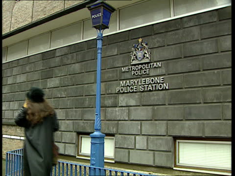 gary glitter questioned by police; itn england: london ext marylebone police station sign on wall lms police man at window - gary glitter stock videos & royalty-free footage
