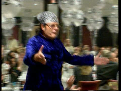 gary glitter questioned by police lnn lib gary glitter along onto stage at dinner - gary glitter stock videos & royalty-free footage