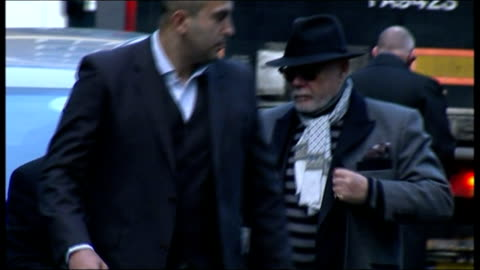 prosecution opens case; england: london: southwark crown court: ext **beware flash photography ** gary glitter getting out of taxi then walking along... - gary glitter stock videos & royalty-free footage