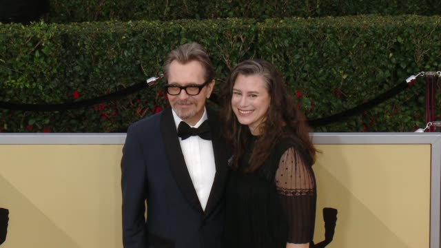 Gary Oldman and Gisèle Schmidt at the 24th Annual Screen Actors Guild Awards at The Shrine Auditorium on January 21 2018 in Los Angeles California