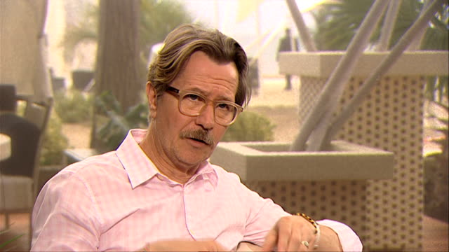 gary oldman on the period of the film at the tinker, tailor, soldier, spy interview: venice film festival 2011 at venice . - gary oldman stock videos & royalty-free footage