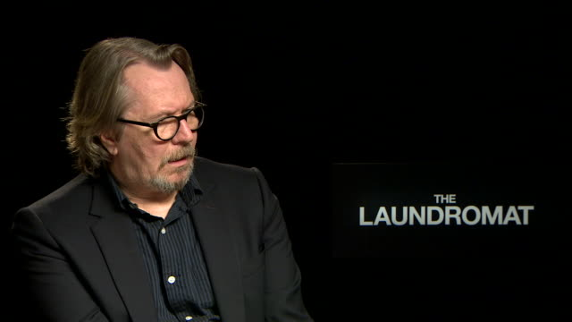 interview gary oldman on wanting to play a banker who had been involved in the panama papers scandal at 'laundromat' interview 76th venice film... - bank stock videos & royalty-free footage