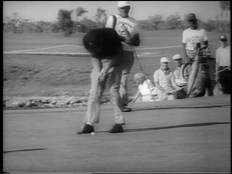 gary player putting perfect putt on windy day at doralryder open / newsreel - doral stock videos and b-roll footage
