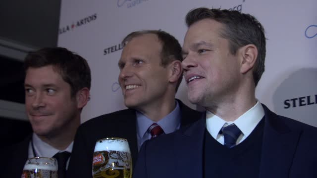 "gary white, matt damon, ricardo tadeu and guests at stella artois & water.org world economic forum panel discussion ""we can be the generation to end... - マット・デイモン点の映像素材/bロール"