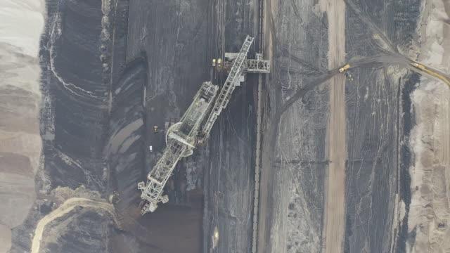 garzweiler lignite mine and manheim village in nordrhein-westfalen, germany, on tuesday, mar 3, 2020. - bagger stock-videos und b-roll-filmmaterial