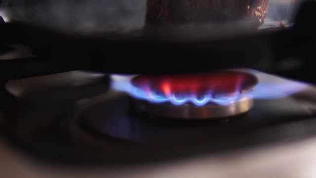 gas burner and roasted steak on a pan. - frying pan stock videos & royalty-free footage