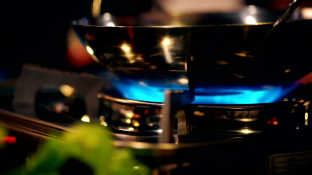 gas burner on mini gas stove with shabu-shabu pot on the table. - gas stove burner stock videos and b-roll footage