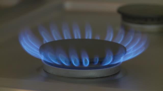 cu, gas burner turning on / atlanta, georgia, usa - ガスコンロ点の映像素材/bロール